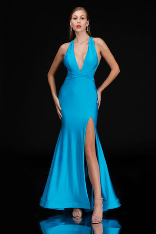 Nina Canacci 1475 is a long fitted prom dress featuring a deep v plunging neckline with an open back and side cut outs. fit & Flare silhouette with a slit in the skirt. sweeping train. Backless Formal Evening Gown  Available Sizes: 0-12  Available Colors: TURQUOISE, FUCHSIA