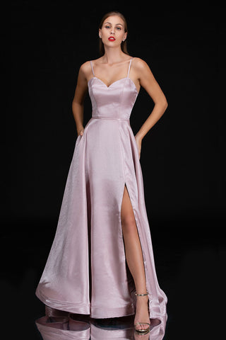 Nina Canacci 1482 is a shining sweetheart neckline prom dress with spaghetti straps. Fitted bodice with a high slit maxi skirt. This is a stunning simple destination wedding dress in ivory or wedding guest gown or Bridesmaid dress in Blush!  Available Sizes: 4-20  Available Colors: Blush, Ivory
