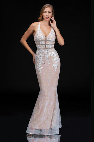 Nina Canacci 1487 is a long fitted cracked ice Glitter prom & Pageant Dress. Featuring & Fit & Flare Mermaid Silhouette with an Embroidered Embellished Lace Plunging Neckline Bodice with a spaghetti strap wrap around backless corset lace up tie closure, Stunning Formal evening Gown. Featuring rows of crystal rhinestones creating an embellished waist belt. Simple & Fun Destination wedding dress in White!  Available Sizes: 0, 2, 4, 6, 8, 10, 12  Available Colors: White, Rose Gold, Silver