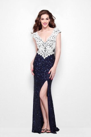 Primavera Couture 1573 cap sleeve v neckline with side slit fully beaded long prom dress in Midnight/White size 00.  This formal dress features a white beaded bodice beaded in a figure flattering design that goes to a v at the waistline creating a slimming effect.