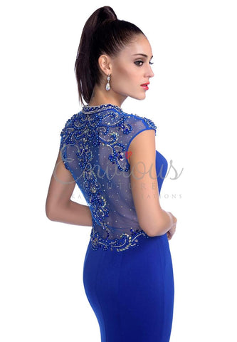 Envious Couture 16147 Long fitted jersey embellished sheer high neckline. Royal Blue sizes 0, 6, 8 in stock fitted jersey prom dress with sheer embellished back and neckline with side slit