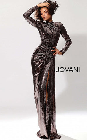Jovani 1707 is a Long Metallic Fitted Evening Gown. Featuring long sleeves & a high neckline. Asymmetrical Ruched bodice cascading along the form fitting silhouette. High slit separating at the gathered hip. Completely closed back. Stunning Evening Gown! 2020 Prom Dress Pageant Gown Stretch metallic fabric, form fitting silhouette, floor length with high tigh slit, ruched bodice with long sleeves, high neckline, close back.  Available Colors: black/red, blush, copper, gunmetal/gold, light-blue, pink, slate