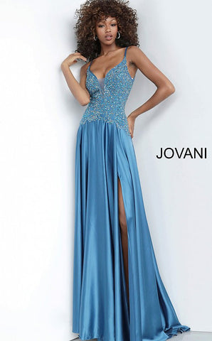 Jovani 4287 is a Long Satin Maxi Prom Dress with an Embellished Bodice and deep V plunging Neckline. Pageant Gown Drop Waist Embellished & Beaded Sheer Bodice. Open V Back. Glass Slipper Formals Pageant gowns.   Available Sizes: 00-24  Available Colors: black, fuchsia, peacock