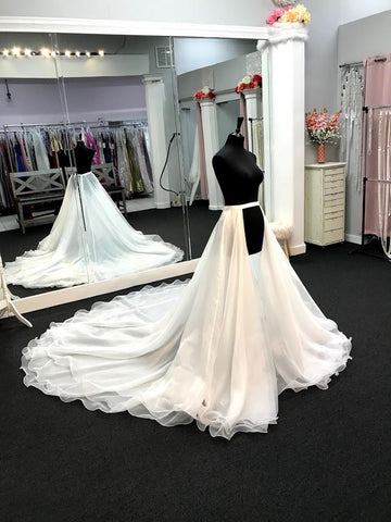Ashley Lauren 1739 is a Long cathedral length organza multi layered overskirt with a ruffle hem. This Pageant & Bridal Over skirt is a Truly stunning addition to any gown!