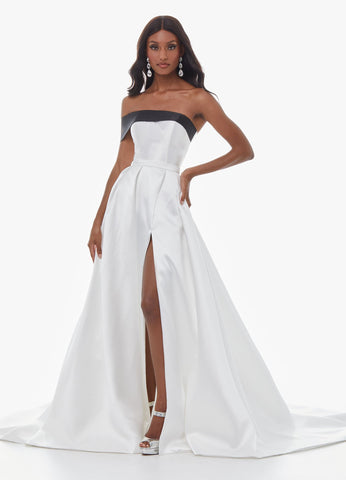 Ashley Lauren 11022 This asymmetrical off shoulder mikado pageant gown has an A-Line skirt, left leg slit and sweeping train. This evening gown is perfect for your next pageant, prom or special event.   Colors Black/White, Magenta  Sizes 0, 2, 4, 6, 8, 10, 12, 14, 16,  One Shoulder Off Shoulder Slit A-Line Mikado