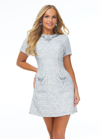 Ashley Lauren 4431 Gorgeous tweed cocktail dress featuring a crew neckline accented by an ornate bead pattern. The beading is continued onto the skirt pockets.  Colors  Blue, Blush  Sizes 0, 2, 4, 6, 8, 10, 12, 14, 16  Tweed Beaded Accents Crew Neckline Pockets