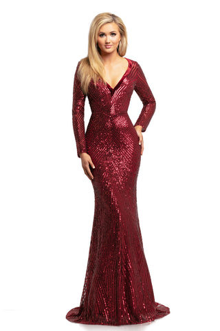 Johnathan Kayne 2020 is a long sleeved sequin Pageant Gown, Prom Dress & Formal Evening Gown. Featuring a sequin Embellished mesh material with asymmetrical patterns for a slimming effect. Long sheer sequin mesh sleeves. Stunning V neckline with velvet edges. Closed sequin embellished back with small train. Fitted silhouette.