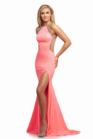 Johnathan Kayne 2023 is a mermaid Prom Dress, Pageant gown & Formal Evening Wear Dress. This Long Fit & Flare Mermaid Prom Dress Features a High Neckline with sheer embellished side cutout and illusion straps. Leading around to a sheer Illusion Embellished Back.  Skirt features a slit and sweeping train.