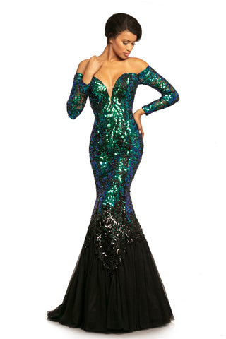 Johnathan Kayne 2062 is an off the shoulder Prom Dress, Pageant Gown & Formal Evening Wear. Featuring stunning Off the shoulder Sequin Embellished Sheer Long sleeves. Plunging neckline with mesh insert. Fitted Bodice with Lace up Corset Tie closure in the back. Lace Appliques cascade from the bodice into the trumpet skirt featuring glitter shimmer tulle with small sweeping train.