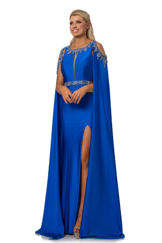 Johnathan Kayne 2075 is a Cape Prom Dress, Pageant Gown & Formal Evening Wear. This 4 way stretch Lycra gown features an Embellished illusion plunging high neckline. Embellished Over Cape Features Shoulder cutouts with a keyhole cutout in the back. skirt features a slit.