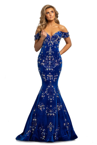 Johnathan Kayne 2176 is a long fit & Flare Mermaid Silhouette Crushed Velvet Formal Evening Gown. This Pageant Dress Features Crystal embellished off the Shoulder sleeves and a sweetheart Plunging neckline. Lush Trumpet skirt with sweeping train. Bodice is embellished with hand beading and crystal rhinestones. Prom Dress Evening Gown   Available Colors: Periwinkle, Royal