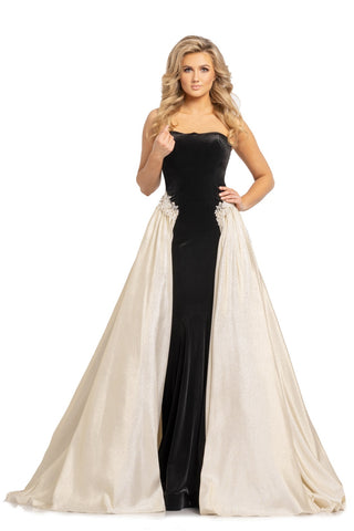 Johnathan Kayne 2199 is a long Black Stretch Velvet Fitted formal dress with a strapless straight neckline. This Stunning Formal Pageant gown features a Metallic Shimmer Brocade pleated Over skirt. The Over skirt & velvet prom dress are connected with an Embellished floral embroidered edge. Stretch Lining, Stretch Velvet