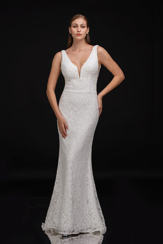 Nina Canacci 2229 is a Long Fitted solid Ivory Lace formal destination wedding dress, pageant gown & informal Bridal. Featuring a plunging V Neckline and open V Back. small sweeping train.