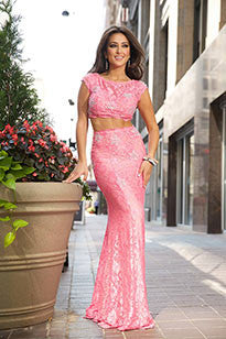 Jovani 24221 is a Beautiful cap sleeve lace two piece formal prom dress featuring crystal adornments and an open back. sheer illusion high neckline with cap sleeves. 2 Piece crop top Lace Formal Prom Dress Cap Sleeve Backless Gown Crystal Rhinestone embellished with a sheer illusion high neckline and cut out back.  Available Size: 8  Available Color: Pink