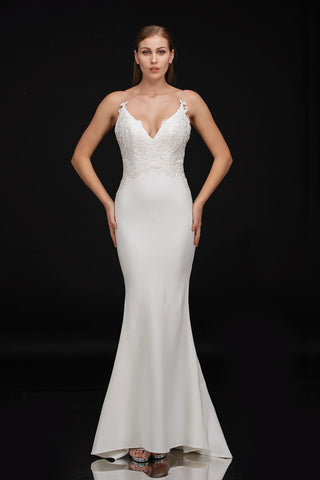 Nina Canacci 3154 is a long fitted sheer floral lace appliques along the sheer fitted bodice. V Neckline with spaghetti straps. Fit & Flare Mermaid Silhouette with sweeping train. Perfect sexy wedding dress or bridal gown  Available Sizes: 0-14  Available Colors: Diamond White