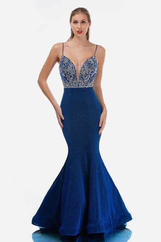 Nina Canacci 3160 is a long Glitter Knit Long Fitted Mermaid Fit & Flare Silhouette Prom Dress with a lush trumpet skirt and sweeping train. Embellished Crystal Rhinestone bodice with a deep V plunging neckline and spaghetti straps. Great Pageant Dress  Available Sizes: 0-16  Available Colors: Royal