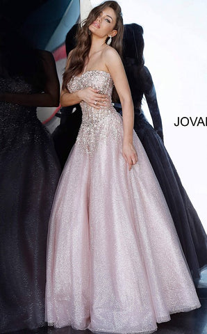 Jovani 3621 Long Sheer Corset Bodice with boning. Crystal Embellishments cascade from the top of this Prom Dress. Lush Ballgown Skirt is accented with Glitter patterns.  Jovani Prom Dresses   Long blush pink glitter strapless sweetheart designer prom ballgown with a sheer beaded bodice by Jovani.  Available Sizes: 00-24  Available Colors: Blush
