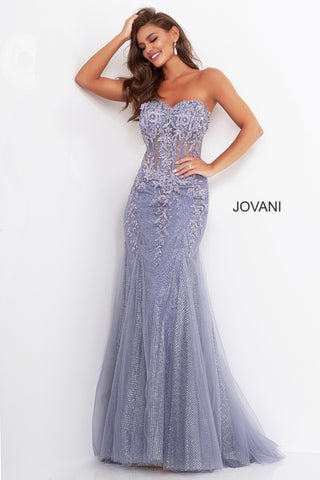 Jovani 3623 is a Stunning Long Fitted mermaid silhouette prom dress. Strapless sweetheart neckline with a fitted sheer corset style bodice with embellishments & 3D Floral Appliques. Glitter knit fabric adds a touch of glam where the appliques cascade down & disperse towards the trumpet skirt with tulle. Available Sizes: 00,0,2,4,6,8,10,12,14,16,18,20,22,24  Available Colors: Grey/Purple