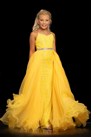 Sugar Kayne C117 by Johnathan Kayne is a Luxurious Lace Fitted stretch lace Girls Pageant Dress with over skirt. Embellished with crystal Rhinestones. This v neckline gown has a Cut Glass Embellished waist belt Connecting the Lush Organza Overskirt with a ruffle hem. Girls & Preteens Formal Gown.  Color Canary Yellow  Size 8