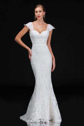 Nina Canacci 4203 is a long fitted embellished lace mermaid wedding dress. featuring a sweetheart neckline with cap sleeves with eyelash lace and a sheer lace back. Great destination bridal gown. Great for Plus Size. Mermaid fit & Flare Silhouette with a trumpet skirt  Available Sizes: 4-24  Available Colors: Ivory