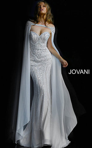 Jovani 45566 is a true stunner! This long Fitted strapless sweetheart neckline features a fully Crystal Embellished and Beaded Vintage Couture Design bodice. Sheer lace underlay. This Wedding Dress is fit for a Goddess. Over the shoulder Crystal embellished Sheer Cape Perfect for cool weather & an magical awe factor. This gown is a true red carpet masterpiece! Fuchsia is a perfect Barbie look for your next Pageant & Is 100% Stage Worthy!   Available Colors: charcoal, fuchsia, ivory  Available Sizes: 00-24
