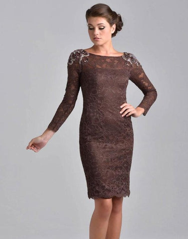 Nina Canacci M208 is a short fitted lace knee length cocktail dress. Sheer High lace neckline with long sleeves. beading, Crystal Rhinestones & Embellishments adorn the shoulder on this great mother of the bride/groom style. Available Sizes: 6, 8, 10  Available Colors: Brown