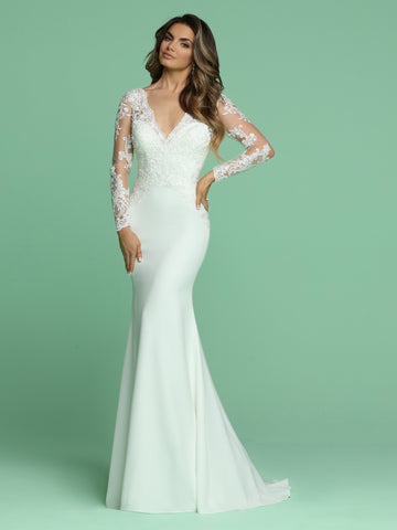 Davinci Bridal 50610 is a Beautiful Embellished Lace Sheer Long Sleeve Bridal Gown Featuring a V neckline with a Crystal & Beaded Fitted Lace Bodice and open V back with buttons running down the hips. Crepe Skirt flowing into a sweeping train.   Available for 1-2 Week Delivery!!!  Available Sizes: 2,4,6,8,10,12,14,16,18,20  Available Colors: Ivory  Available Sizes: 2-30
