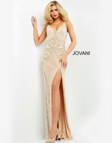 Jovani 62885 Floor length form fitting ivory nude beaded prom dress features high slit and open back bodice with plunging neck and straps over shoulders.  Prom, Pageant, and Formal Evening Gown.  Color Ivory/Nude  Sizes  00, 0, 2, 4, 6, 8, 10, 12, 14, 16, 18, 20, 22, 24