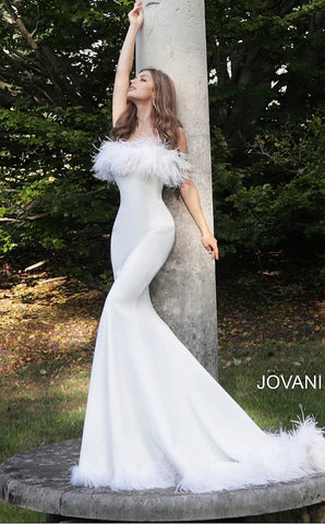 Jovani 63891 straight neckline with feather trim on the neckline and feather trim on the edge of the skirt with a sweeping train fitted mermaid evening gown wedding dress prom gown  Available colors:  Black, Navy, White  Available sizes:  00-24