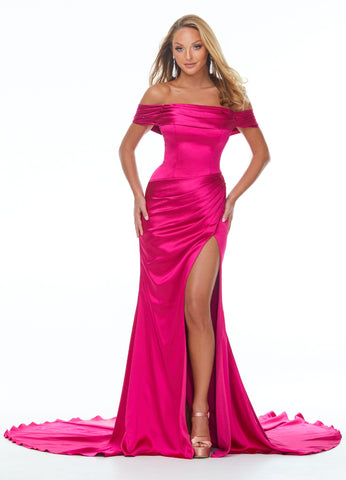 Ashley Lauren 11020 Make an entrance in this off shoulder satin prom dress. The off shoulder strap on this evening gown and waistline are complete with ruching that is perfectly placed to accentuate your curves. The skirt is finished with a left leg slit and sweeping train. Makes an excellent Pageant Gown.   Colors Fuchsia  Sizes   0, 2, 4, 6, 8, 10, 12, 14, 16  Off Shoulder Slit Satin Fitted Train