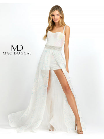 Mac Duggal Cassandra Stone 66858a is a gorgeous Formal Fun Fashion piece! Solid shimmering sequin fitted short romper with a sweetheart neckline with beaded straps. Detachable overskirt is layered with tulle with a sequin tulle overlay for a glamorous affect. Great Fun Fashion! This fully sequined white romper comes with a fabulous overskirt. The overskirt can be left on or taken off for two different looks!  Available Sizes: 0,2,4,6,8,10,12,14  Available Colors: Crystal Ice
