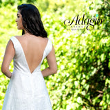 Adagio Bridal D1481 plunging neckline with sheer panel and open back sequined glitter tulle A line destination bridal gown wedding dress Colors  Ivory, White  Sizes  00, 0, 2, 4, 6, 8, 10, 12, 14, 16, 18, 20, 22, 24, 26, 28, 30