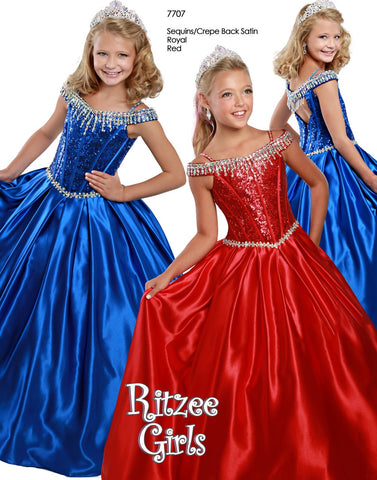 Ritzee Girls 7707 is a long 2020 Satin Ballgown Pageant Dress. This Long Pleated satin ballgown skirt is stage worthy! Sequin Embellished Bodice with boning, Basque Waistline with crystal rhinestone embellishments. off the Shoulder Rhinestone embellished straps leading to an open cutout back with crystal tassels.