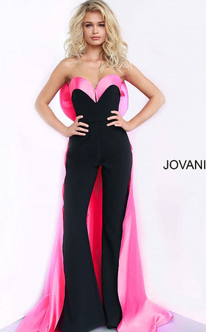 Jovani 8008 is a 2020 Prom, Pageant & Formal Jumpsuit! Featuring a strapless sweetheart neckline with a fitted stretch crepe Bodice & Satin accents along the bust and in the back with the Bow & Train.   Available Sizes: 00,0,2,4,6,8,10,12,14,16,18,20,22,24  Available Colors: black/pink, black/white, ivory/ivory