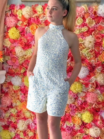 Ashley Lauren 8031 Girls short Fully Embellished Sequin Fun Fashion Romper. High choker neckline with pockets! Perfectly paired with an Ashley Lauren 1740 Organza Layered Overskirt. (Overskirt Sold Separate). Pageant Wear for kids, Preteens & Teens!  Available Sizes: 4,6,8,10,12,14  Available Colors: AB/IVORY, LILAC, MULTI/PURPLE