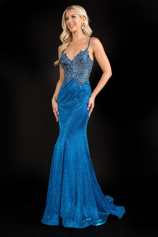 Nina Canacci 3165 is a long Iridescent Shimmer Mermaid Prom Dress. Featuring a sheer Embellished Lace Fitted bodice with a v neckline and a corset lace up tie closure back. lush trumpet skirt with a sweeping train. Crystal Embellished spaghetti straps.  Available Sizes: 0-16  Available Colors: Blush, Royal