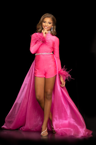 Sugar Kayne C127 by Johnathan Kayne is a girls and preteens pageant romper with dramatic long sleeves trimmed in feathers.  It features an embellished high neckline and embellished waistline and full long overskirt.  It is made of 4 way stretch lycra with an organza overskirt.  Available colors:  Barbie Pink, Royal Blue  Available sizes:  2-16