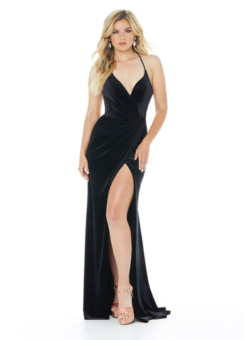 Ashley Lauren 1962 Stunning classic velvet evening gown featuring a dramatic ruching that is sure to show off your curves. The look is completed with a high slit, lace-up back and ruched lower back. Great for pageant dress or for prom.   Available colors:  Black, Red  Available sizes:  0, 2, 4, 6, 8, 10, 12, 14, 16  Wrap Skirt Lace-Up Back Ruched Back Slit Spaghetti Straps