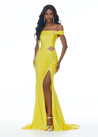 Ashley Lauren 11031 This jersey prom dress has a ruching along the off shoulder straps and waistline, crystal detailing, a modern cut out and lace up back. The skirt on this long pageant evening gown is complete with a left leg slit.  Colors  Yellow, Royal  Sizes  0, 2, 4, 6, 8, 10, 12, 14, 16  Off Shoulder Cut Out Slit Lace up Back