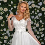Adagio Bridal D9240 is a long Chiffon wedding dress with a Lace Bodice and V Neck. Lace Embellished tulle long sleeves. The back is sheer with lace details and bridal buttons down the back.  Destination Bridal Gown. Wedding Dress.