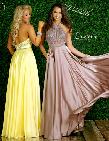 Envious Couture E1404 Karishma Creations is a Long satin A line Prom Dress. High Neck Embellished Bodice with sheer plunging cutout flowing into a satin skirt with pockets.   Available Sizes: 4  Colors: Yellow