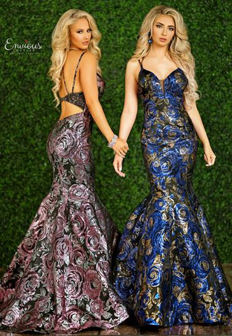 Envious Couture E1476  Karishma Creations is a floral brocade mermaid Prom & Pageant Dress. Featuring a Stunning Metallic Shimmer Brocade fabric for an elegant wow factor. Gorgeous Full Mermaid Silhouette with trumpet skirt. Plunging neckline evening gown with mesh insert. Keyhole cutout back with sheer embellished Wide back pieces.