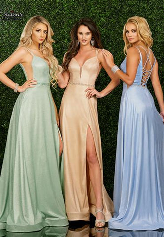Envious Couture E 1562 is a Long Shimmer Prom, Pageant & Formal evening wear dress. Featuring a shimmer Jersey fabric for a glamorous and comfortable fit. Plunging neckline with mesh insert, Crystal embellished waist belt. sheer cutout side mesh panels, criss cross corset style tie back, slit in the flowing skirt.