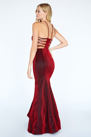 Jolene Exclusive E20025 is a long Fitted Glitter Shimmer Knit Prom Dress & Pageant Gown. This High Neckline gown features an open cutout back with spaghetti strap details. Fit & Flare Silhouette. Great formal Evening Gown. Classic Look.