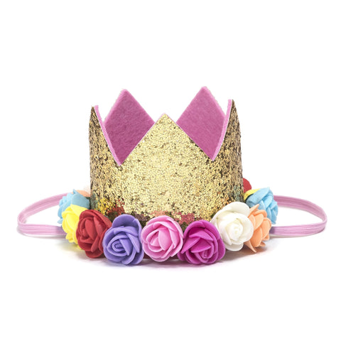 Sweet Wink - The Gold Rainbow Flower Crown is the perfect addition to any birthday party or everyday dress up! Since this crown does not have a number on it, it can be worn for multiple occasions. Makes a great birthday present for any little girl in your life! Item description:  Gold glitter crown Assorted colored flowers trim the base of the crown Light pink felt lining inside the crown and on the bottom of the crown to ensure comfort and softness on the child's head Light pink elastic to secure crown to