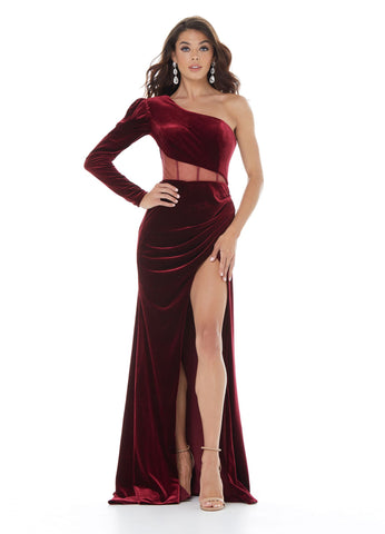 Ashley Lauren 11013 Talk about drama! We love this one shoulder velvet evening gown with exposed boning. The puff sleeve is complete with ruched detail and the skirt is complete with a slit. Prom dress pageant gown.   Colors Black, Burgundy  Sizes  0, 2, 4, 6, 8, 10, 12, 14, 16,   One Shoulder Exposed Boning Puff Sleeve Slit