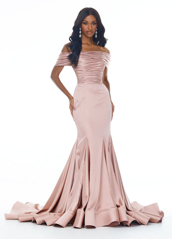 Ashley Lauren 11023 Off the shoulder stretch satin evening gown featuring a ruched bodice giving way to a fit and flare skirt featuring multiple godet insets to provide a full skirt and train. Perfect for your prom, pageant or next formal event.   Colors  Rose Gold, Ivory  Sizes  0, 2, 4, 6, 8, 10, 12, 14  Off Shoulder Mermaid Silhouette Satin Train