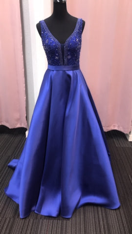JVN67198 Royal Sizes 6  In Stock prom dress Beaded fitted bodice, plunging V neck with sheer mesh insert, sleeveless, V back, floor length a line pleated skirt, sweeping train evening gown. Pockets!!
