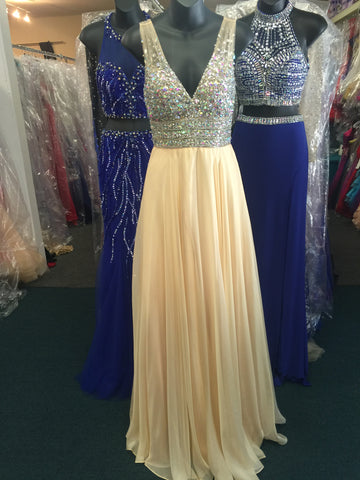JVN20437 Stunning chiffon flowy prom dress features sheer v neck beaded top. Makes a beautiful pageant gown.  In stock in light yellow size 0.