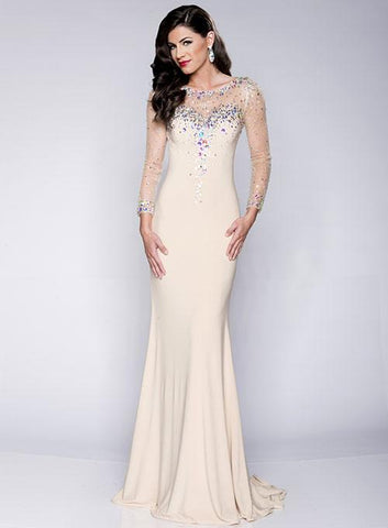Envious Couture 15014 size 00 Champagne long embellished sleeves prom dress is perfect for your special formal event.  Features a sheer neckline and sleeves that are scattered with crystals and a smooth fitted jersey long skirt. Formal Dress Evening Gown